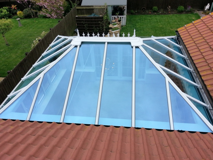 Glass conservatory roof insulated coloured glass Riviera Roofs trade supplier UK quote