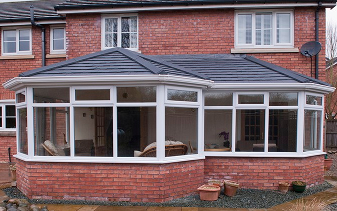 Insulated tiled conservatory roof grey coloured tile replacement new Riviera Conservatory Roofs Ltd