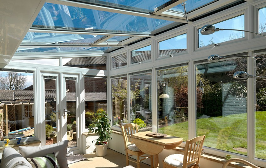 Money saving energy efficient glass conservatory roof replacement Riviera Roofs cosy warm all year round upgrade